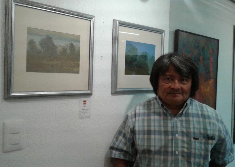 Autores junto a sus pinturas